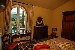 Small Tuscany Cottage with private pool - the yellow  bedroom facin